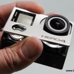 The Hero4 faceplate is still held in place with adhesive tape and tabs, however the button is no longer attached.